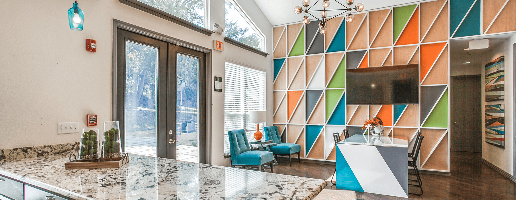 lounge area with modern seating and colorful decor